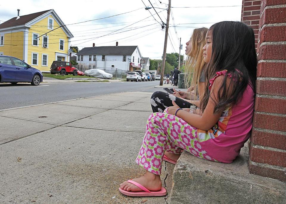 Children watched across the street at the soon to be home of the defrocked Catholic priest Paul Shanley on Pulaski Street on Friday.